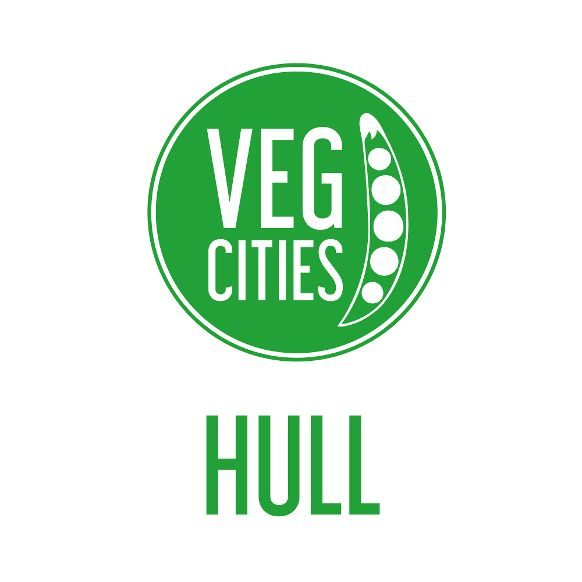 Veg cities logo with peas in a pod inside a green circle.